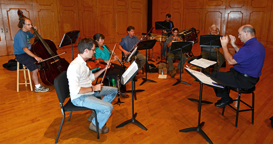 "Members of the Northwestern State University Faculty Chamber Players rehearsing Stravinsky's ""L'Histoire du Soldat"" (The Soldier's Tale) are front from left, Andrej Kurti on violin, Malena McLaren on clarinet, Douglas Bakenhus on bassoon, Galindo Rodriguez on trumpet, J. Mark Thompson on trombone, conductor Jeffrey Mathews and back from left, Peter Haas on double bass and NSU student Russell Lancaster of Carthage, Texas, on percussion."