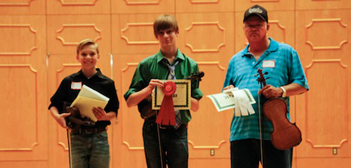 Winners in the Louisiana State Fiddle Championship held during the Natchitoches-NSU Folk Festival were, from left, Carson Taylor, first;  Hal Mayfield, second place, and Ron Pace, third place.