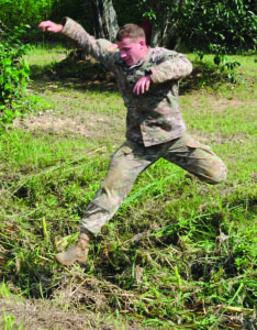 Spc. Steven Huffstutter, Headquarters and Headquarters Company, 46th Engineer Battalion, leaps over a muddy ditch during the air assault obstacle course phase of the Joint Readiness Training Center and Fort Polk NCO and Soldier of the Year competition June 15.