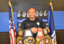 APD officer boxes for charity, honoring fallen officers